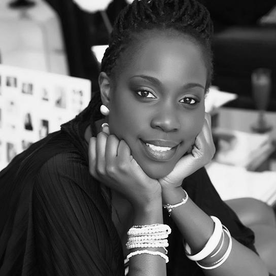 Headshot of Edleen John in black and white