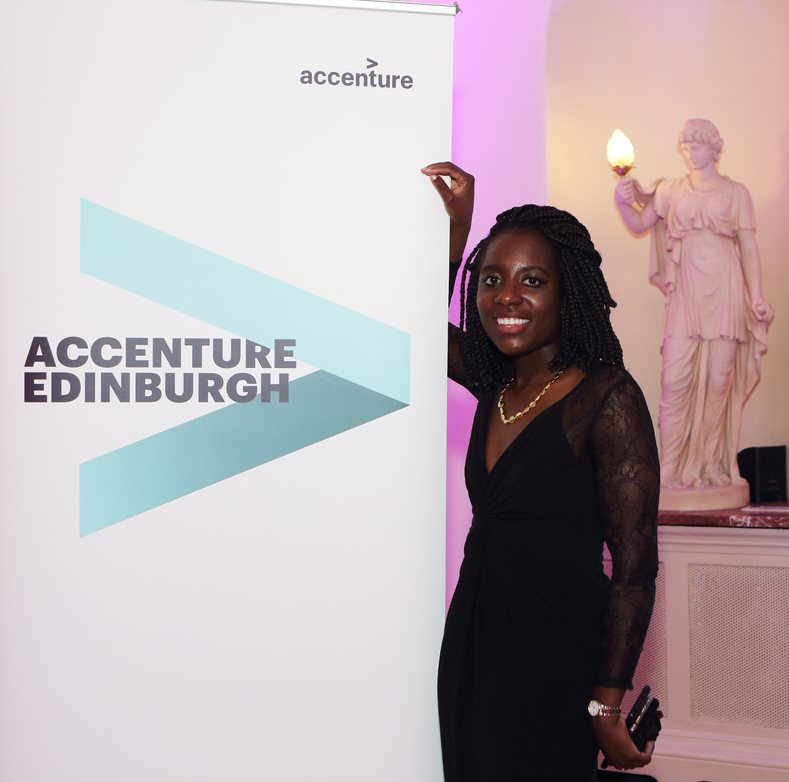 Janet standing next to an Accenture Edinburgh sign