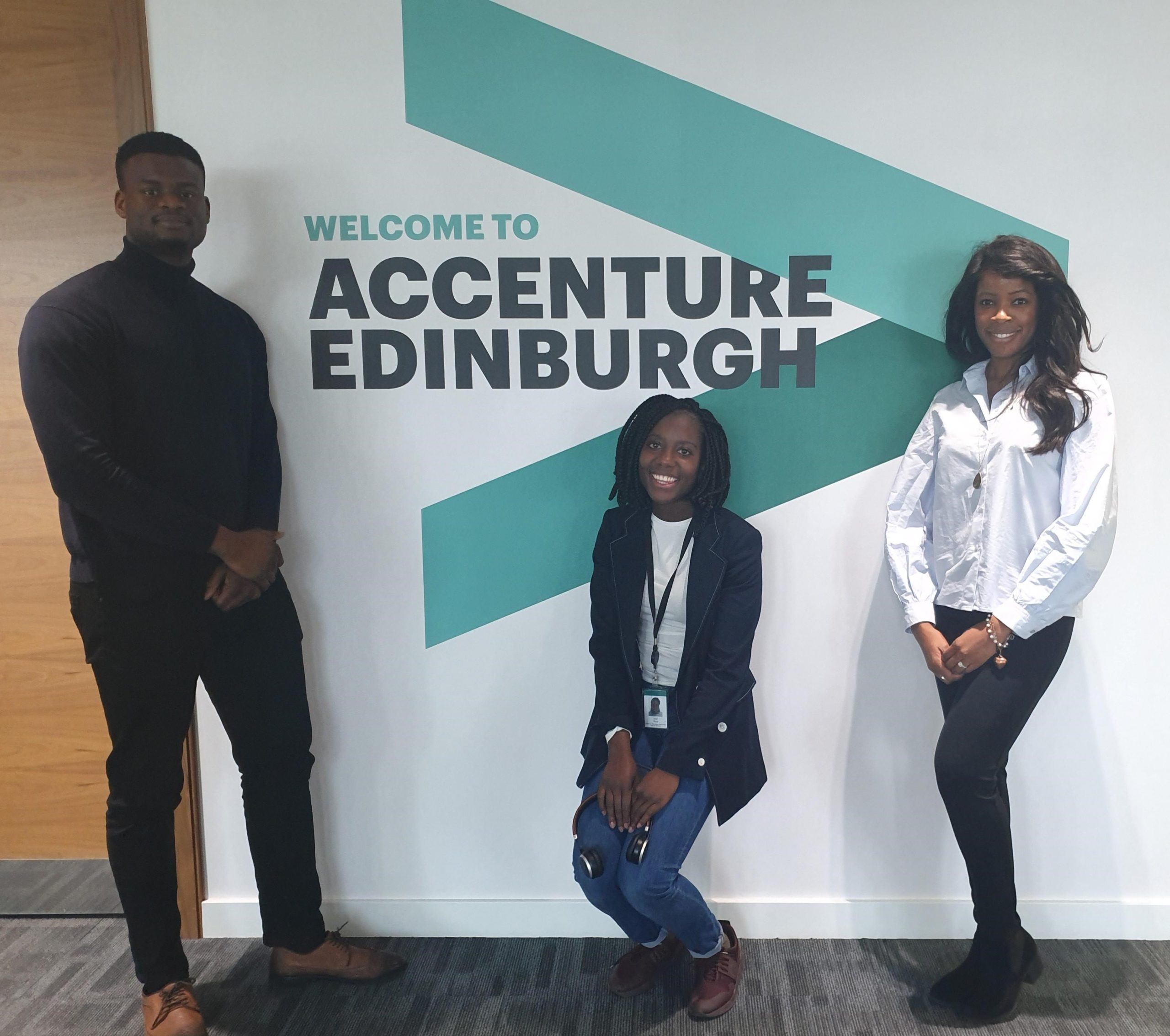 Janet and two colleagues standing in front of Accenture Edinburgh sign