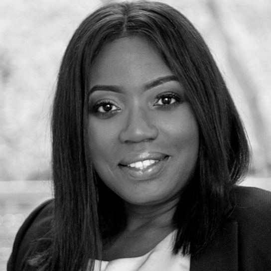 Headshot of Roni Savage in black and white