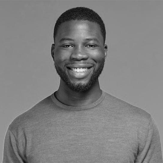 Headshot of Toib Olomowewe in black and white
