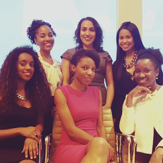 Six black women sitting and smiling at the camera